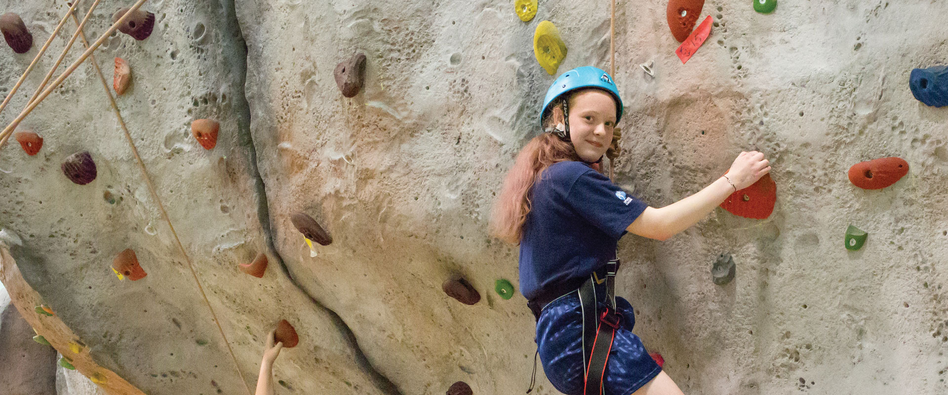 Student climbing wall